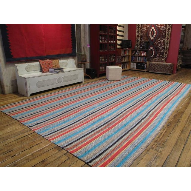 An unusually large and colorful flat-weave from Central Turkey, woven with an ingenious mixture of cotton rag and wool....