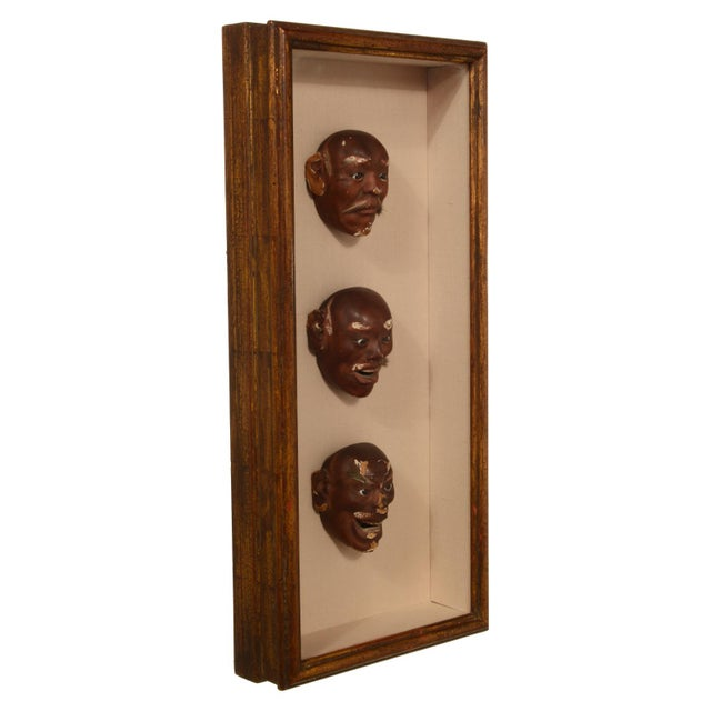 This lovely collection of Antique Japanese Noh Mask are displayed in a classic wood framed shadowbox, ready to hang. The...
