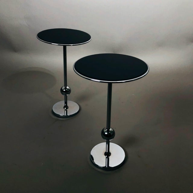 Pair of chrome Tecno T1 side tables with reverse painted black lacquered glass tops by Osvaldo Borsani.