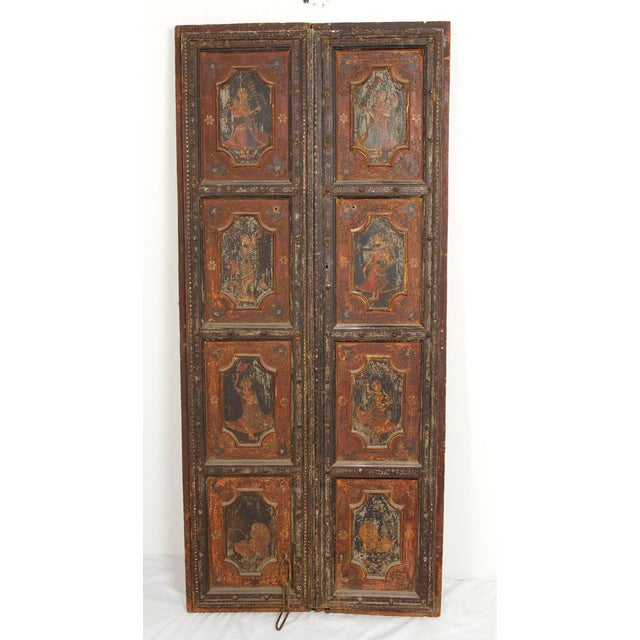 A fantastic painted pair of doors from India made in the 19th century. From an old San Francisco collection. Exported from...