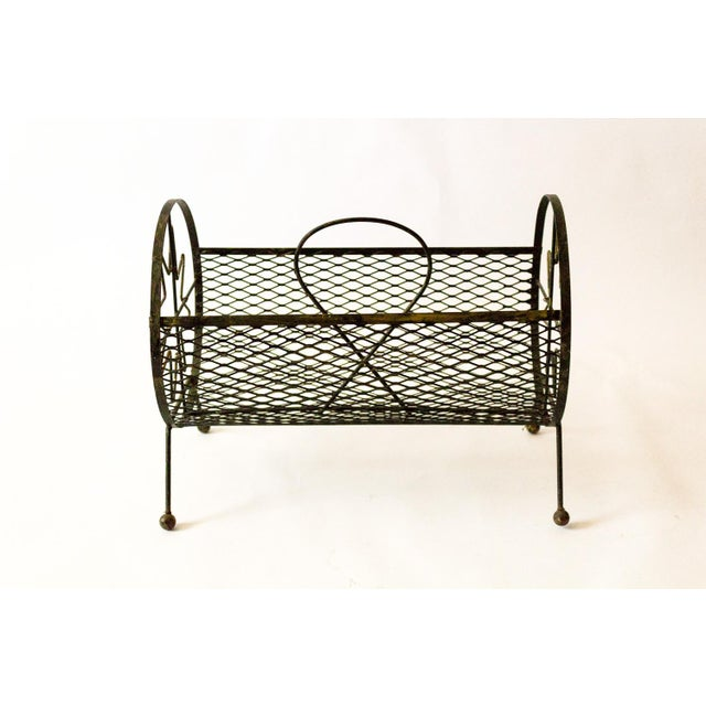 Unique mid-century round magazine rack with a starburst motif on each end. A truly gorgeous little piece with lots of...