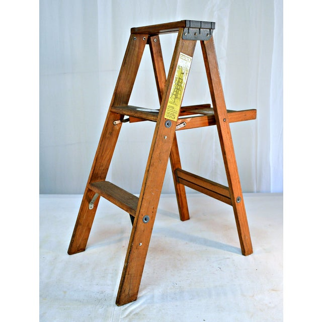 Nice original natural colors. Great for display or use as a shelf. This two step wooden ladder with a tool shelf is...