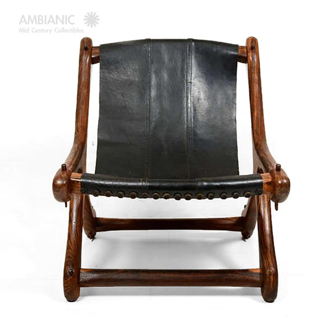 AMBIANIC is please to offer a vintage sling chair designed and produced by Don Shoemaker. Rare solid Cocobolo frame with...