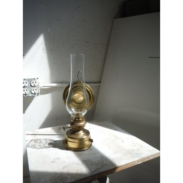 This vintage kerosene lamp was discovered in a flea market in Brittany, France. The unit is operational and still has its...