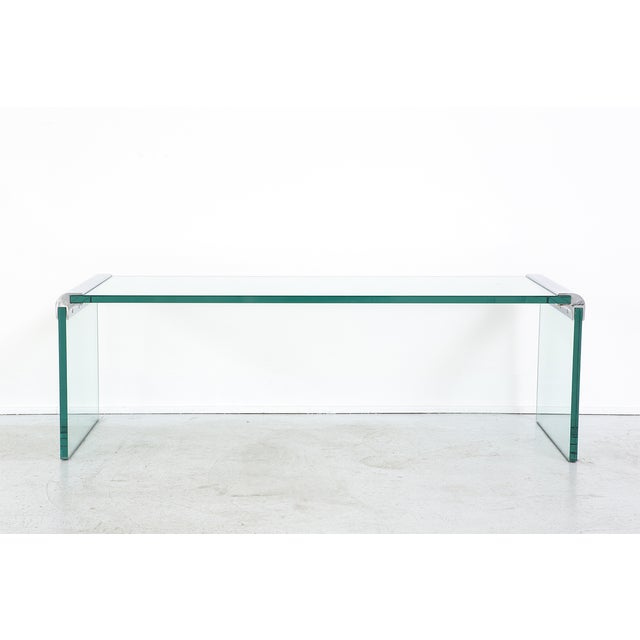 "waterfall coffee table designed by Leon Rosen for Pace Collection USA, c 1960s glass + chrome 16"" h x 50 ¾"" w x 17 ¾"" d x..."