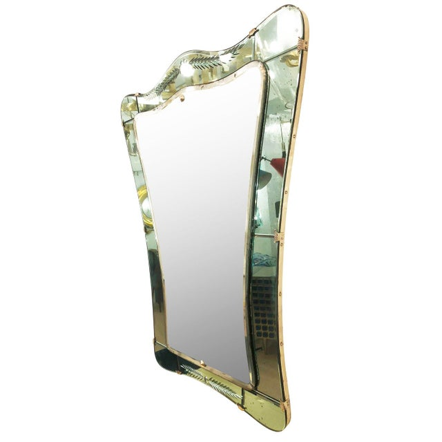 1950's Cristal Art mirror with an etched acqua colored frame and brass details.