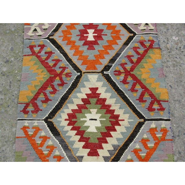 Vintage handwoven Turkish kilim rug. The kilim is nearly years 40 old. It is handmade of very fine quality natural wool in...