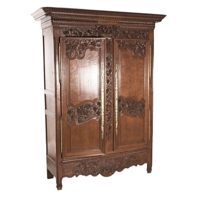 Early 19th Century French Carved Floral Motif Marriage Armoire For Sale