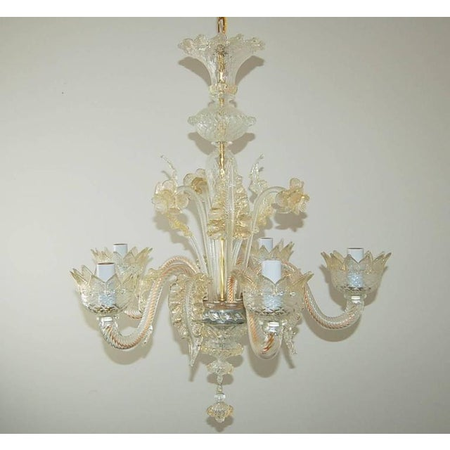 Elegant vintage Venetian five-light Murano glass chandelier, 1950s, made of Murano clear crystal filled heavily with gold...