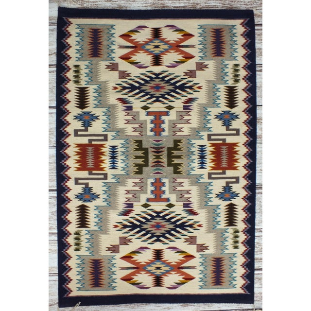 """Authentic Navajo rug in the """"Storm"""" pattern made in 1987 by renowned weaver Lily Touchin. In new unused condition with..."""