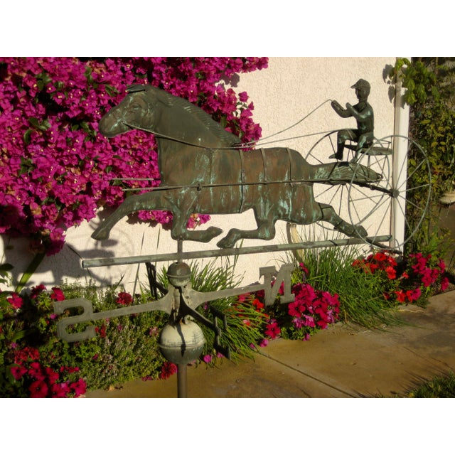 Lovely and complete model ,( pole , N,S,N,W, sign horse and jockey subject) of weathervane , horse and buggy and jockey...