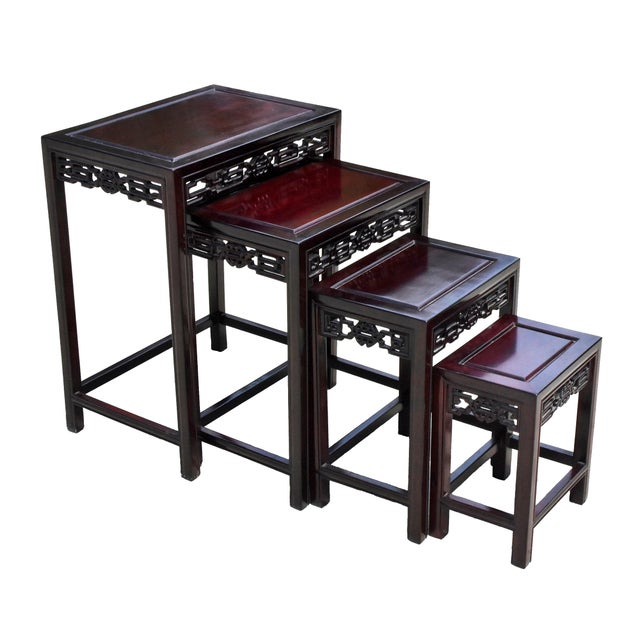Extraordinary set of four nesting tables in excellent condition. Beautiful fine grade solid rosewood. Carved scrolls of...