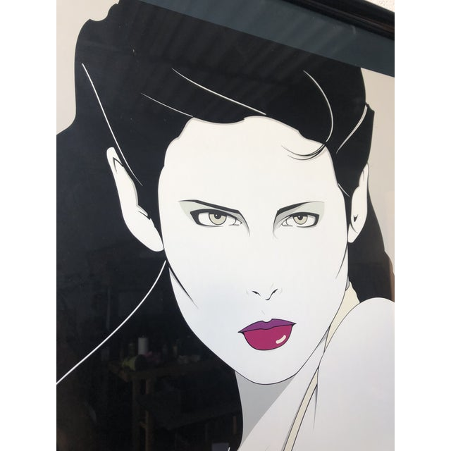 1980s Patrick Nagel the Book Framed Lithograph Poster, published by Mirage Editions in 1981. Patrick Nagel American...