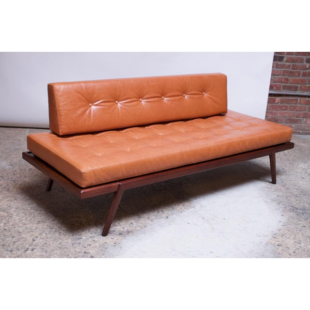 Daybed / settee designed by Mel Smilow for Smilow-Thielle in the 1950s. Solid walnut construction with newly upholstered...