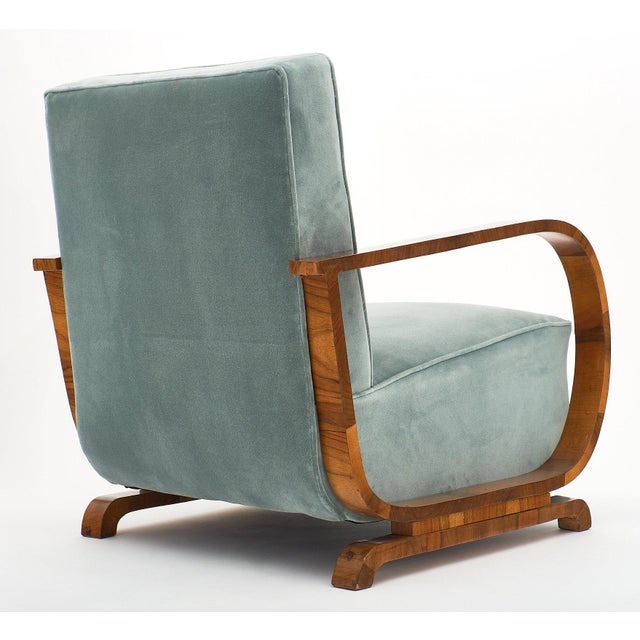 A pair of Art Deco Austrian armchairs from Vienna, reupholstered in a new aqua velvet blend. The frame and curved arms are...