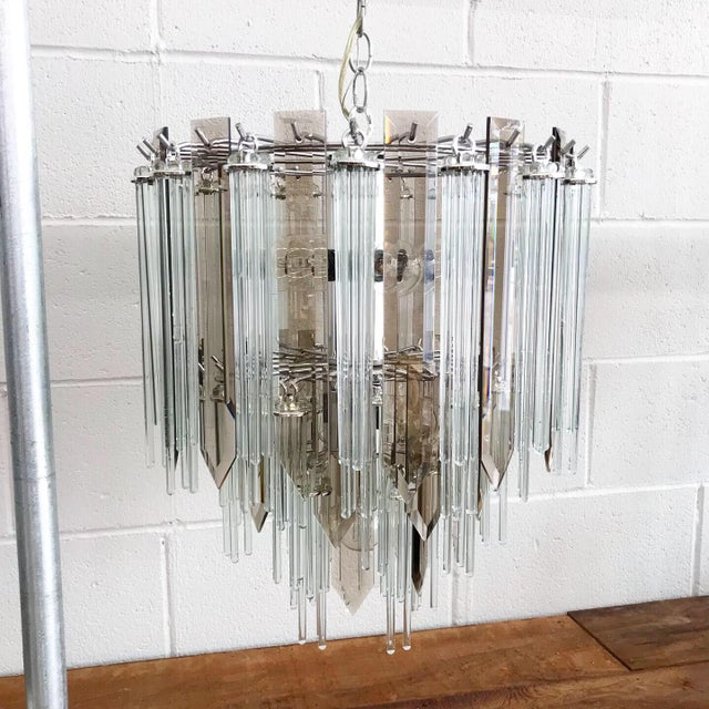 Elegant mid century modern chandelier with glass reeds and glass prisms. This pairs nicely over a dining set or in an...