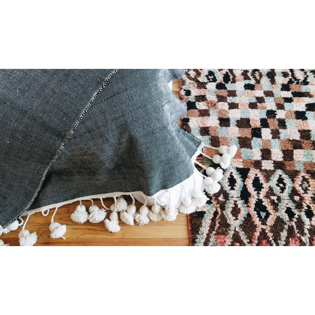 This beautiful wool blanket was handcrafted by a master weaver in the souks of Marrakech, a craft that has been passed...