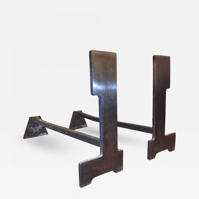 FRANCOIS MONNET 1970s pair of brushed steel andirons.
