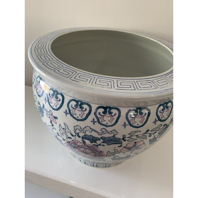 Chinese floral decorated porcelain planter/fish bowl style, jardiniere. Greek key design around rim. Decorated with lotus...