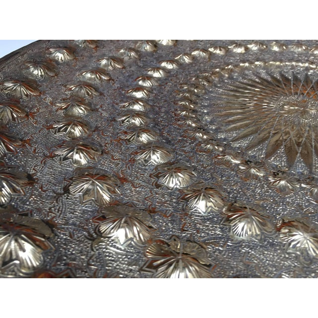 Large handcrafted antique Indo-Persian hammered brass metal tray. Heavy brass with very fine repousse art work. The stand...