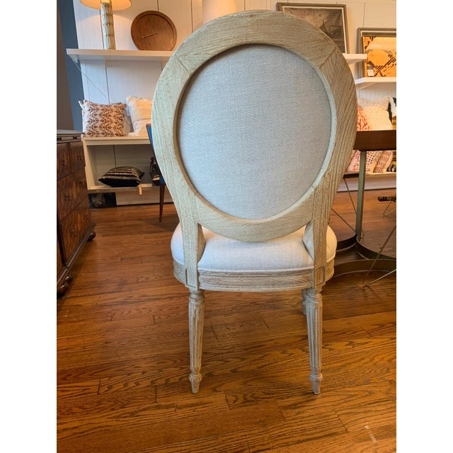 Alluding to traditional French style, this oval-backed chair is finished in a rustic, weathered Swedish blue coloration,...