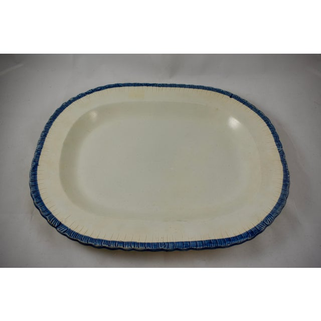 A heavy Leeds style oval platter, a Pearlware or Creamware body with a deep blue edge called Feather or Shell. Circa...