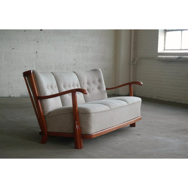 Rare and sought after sofa model 1594 made by Fritz Hansen, Denmark in the early 1940s. The sofa was featured in Fritz...