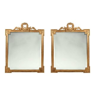 Early 20th Century Matching Pair of Giltwood Hanging Beveled Mirrors For Sale
