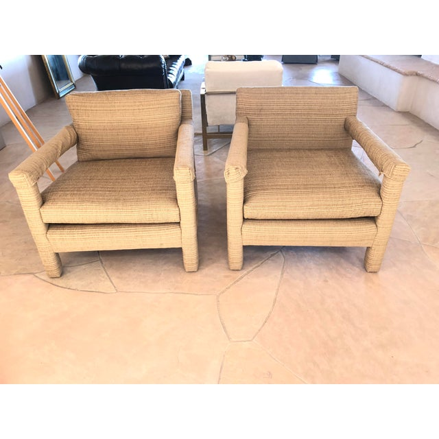 Gorgeous modern lounge chairs. Sold as a pair. The back cushion is missing on one of them. They have arm covers. Could...
