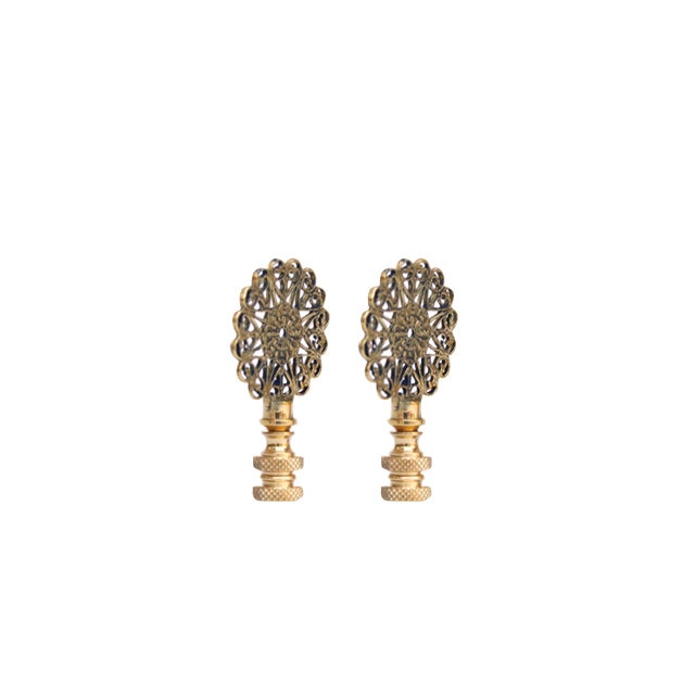 A pair of lacy brass lamp finials. Fits a standard size lamp harp. Dimensions per finial. We have more lamp finials...