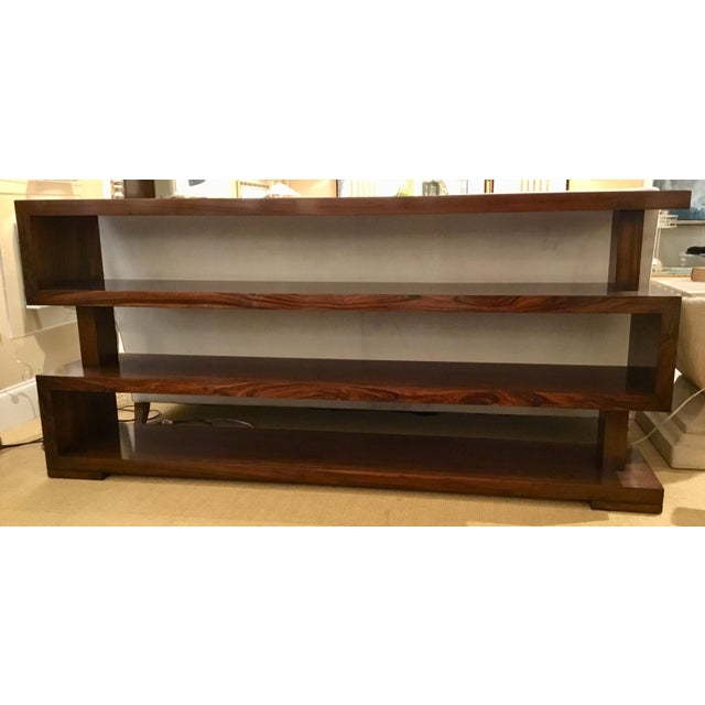Sculptural organic John Richard Bolton Bookcase finished in an opulent mahogany, showroom floor sample, original retail $3465