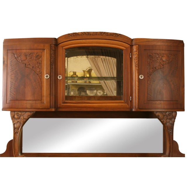 Offered is a beautiful art deco style dining room buffet/server circa 1920s. This piece is made from walnut with ample...