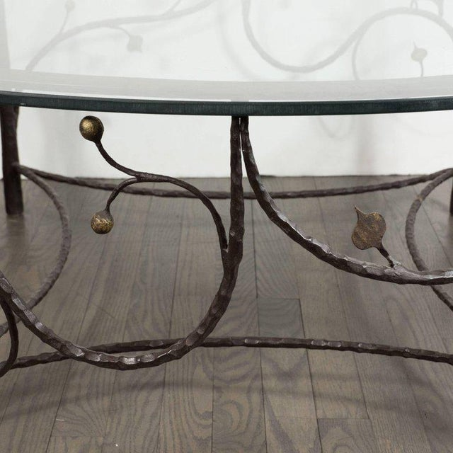 This whimsical yet sophisticated coffee table was realized in the United States, circa 1960. It features four legs that...