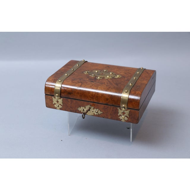Superb antique English burl walnut brass bound compendium games box with fully fitted interior. Contents include, original...