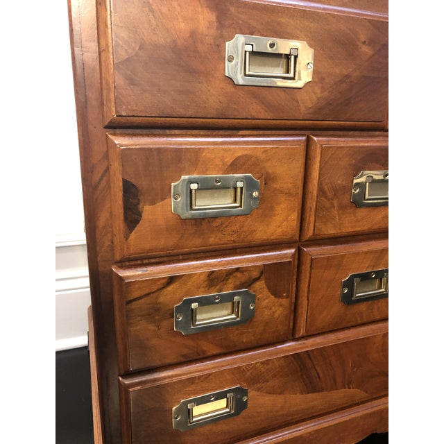 Offered is a vintage campaign style chest of drawers. This piece features compartmental storage drawers and is stamped...