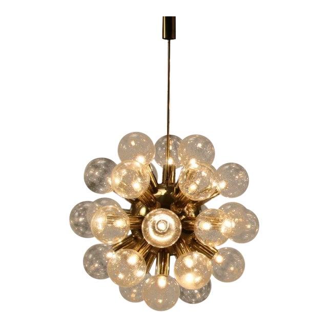 One of Robert Haussmann Brass Sputnik Pendants Holding Twenty Eight Bulbs For Sale