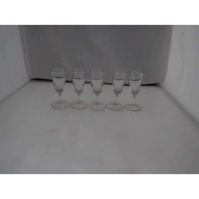 Midcentury Clear Glass Set of five Shot Glasses, No makers mark in excellent condition.