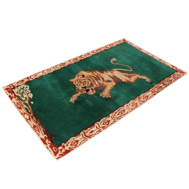 Hand knotted in Turkey originating between 1950-1960, this vintage mid century wool rug enjoys one of the more uncommon,...