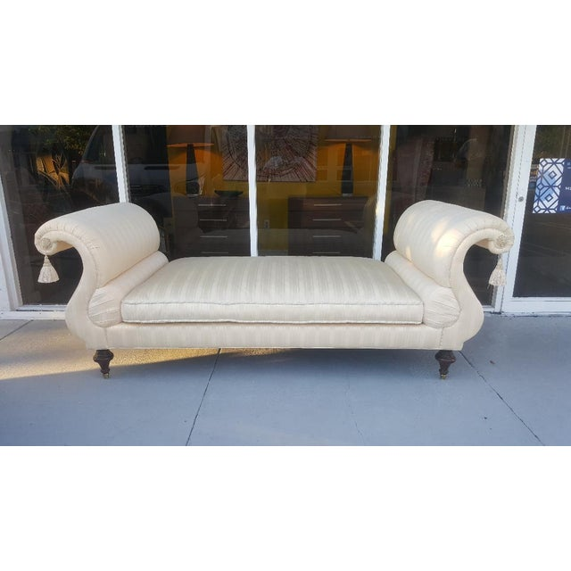 This is an elegant Empire styled, upholstered daybed, by Baker Furniture of High Point, North Carolina. The piece has...
