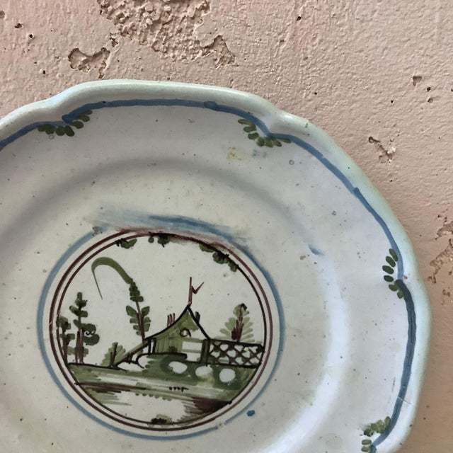 18th century French faience Nevers plate. House with trees on the center.