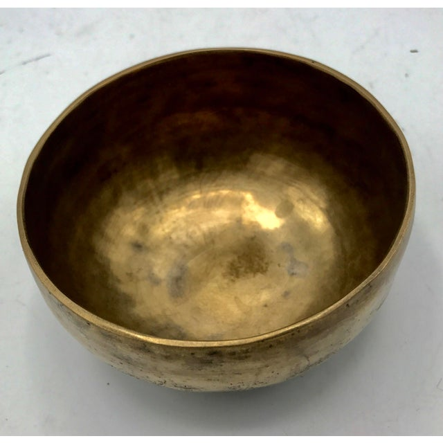 This Early 20th Century Tibetan Brass Singing Bowl rings like a bell with perfect acoustics. Just ringing it once with a...