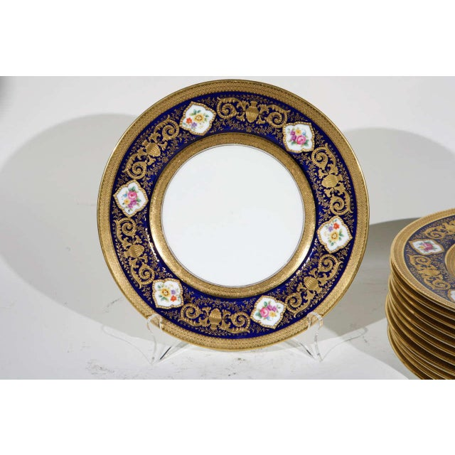 Set of 12 English Cowell and Hubbard Company Plates. They are hand painted with raised gold decoration. H 0.05 in. x Dm...