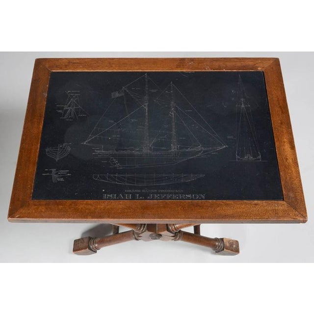 Low side table with an inset slate top engraved with blue prints of a clipper ship 'The Isiah L. Jefferson'. The top inset...