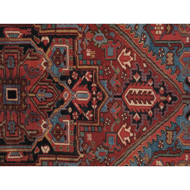 A hand-woven mid-20th century, vintage Persian Heriz carpet. Rug has been professionally washed.
