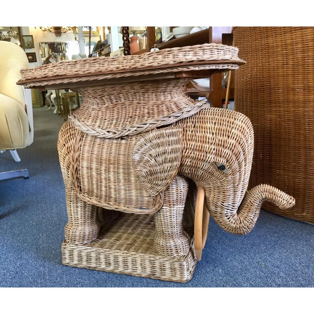 A striking Italian woven rattan side tables with removable tray top in form of an Elephant. Woven rattan will go great...