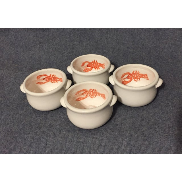 This set of four Italian Majolica individual shellfish clarified butter ramekin bowls feature lobsters on the side...