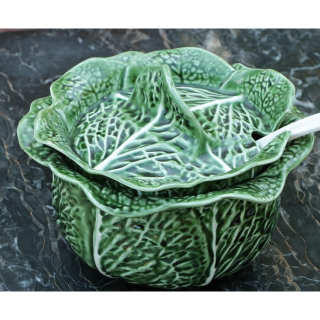 Lidded majolica tureen, made in Portugal. Hand-painted in rich green with whimsical, coordinating ladle. From SECLA.