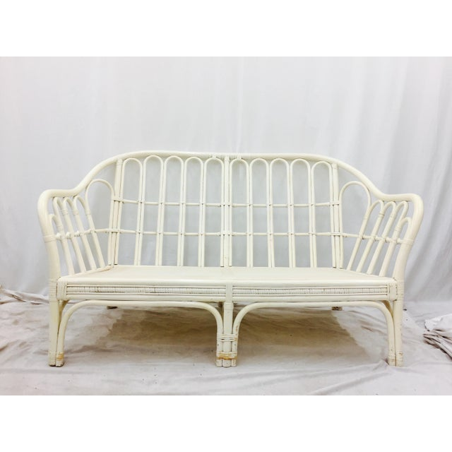 Vintage Palm Beach Chic Franco Albini Style Bent Rattan Love Seat Sofa. Original white Lacquer Finish, shows slight wear....