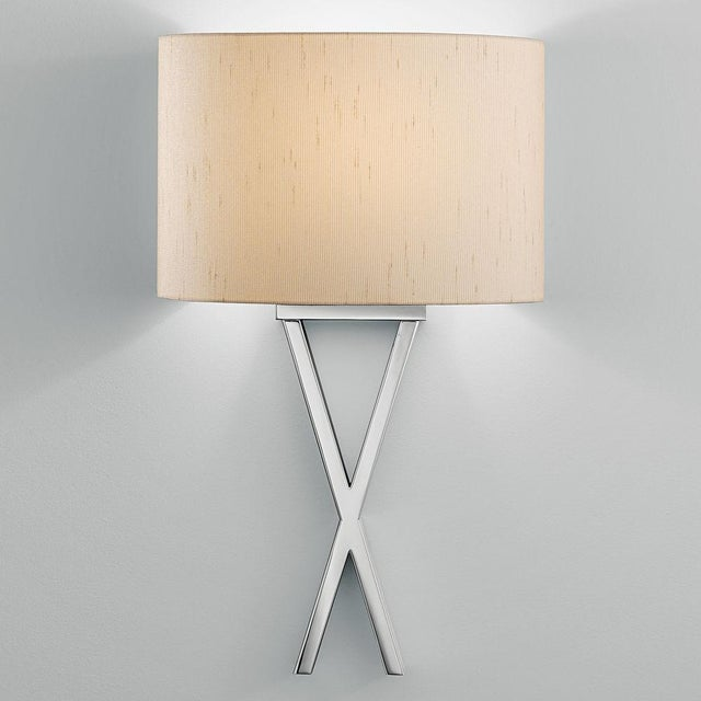Polished Chrome wall light. Crossover sections pass one in front of the other. Measurements below in inches.