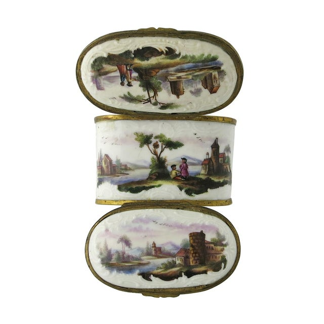 A fine and rare Continental enamel on copper double sided snuff box, probably German. The box is oblong in form with with...
